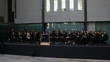 Sir Simon Rattle conducting the LSO in rehearsal at Tate Modern.