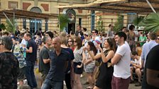 Festival goers dance to Norman Jay MBE