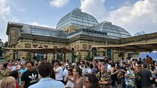 Revellers against the backdrop of Ally Pally