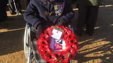 Margaret in her chair with her poppy wreath