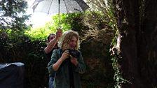 Matt Reid shelters Teddy from the sun/rain