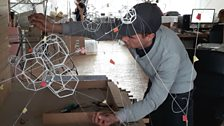 Sebastian the architect building a model to test if Tomás's idea for an 'epic-sized' cloud sculpture can be made.
