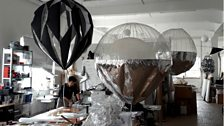 Working on the hot air balloon sculptures that will rise and fly using only the heat of the sun, and the wind