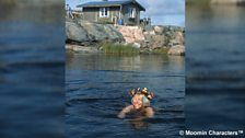 Tove Jansson swimming near her house on the tiny island of Klovharun in the Finnish archipelago
