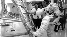 Neil Armstrong practises climbing into Apollo 11's Lunar Module