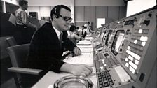 Flight controller Stephen Bailes at mission control console