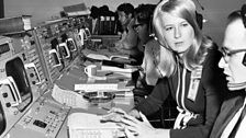 Computer engineer 'Poppy' speaks to a colleague in Nasa's Mission Control