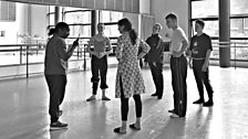 Sharon Watson leads the finalists in rehearsals for the group dance