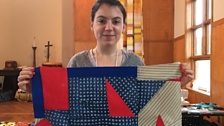 Zoe with her red triangle quilt