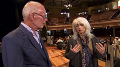 Emmylou Harris reminisces onstage at the Ryman Auditorium