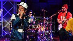 What song does ex-Elvis impersonator Bruno Mars sing in the shower?