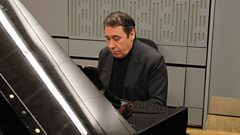 Jools Holland boogie-woogies to the Grand Hotel