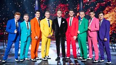 Eight of the boys perform with Olly Murs
