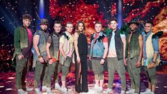 Eight of the boys perform with Melanie C