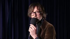 Jarvis Cocker and Chilly Gonzales perform a track from their new album about a hotel room… at Elton John's Piano