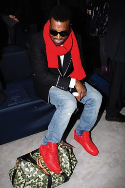 c54400fd1cdc Kanye West wearing Louis Vuitton shoes he designed at the Louis Vuitton  fashion show during Paris Fashion Week