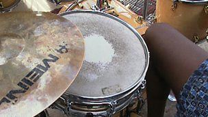 Playing percussion with a steel band