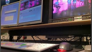 Three screens with video editing software showing on them.