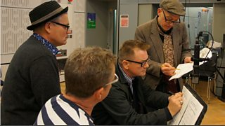 Writer, Mark Davies Markham, gives notes to Madness in the studio.