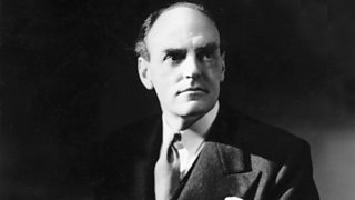 A striking black and white image of John Reith in a suit, looking wistfully into the middle distance.