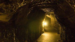 Dimly lit underground tunnel.