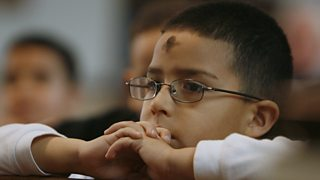 Child at Ash Wednesday ceremony, USA