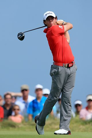 Rory McIlroy hits off the ninth tee