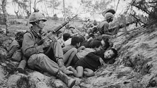 American soldiers in a trench with some Vietnamese children