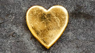 A golden heart on the ground