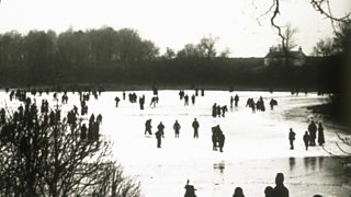 People skating on a frozen pond in Scotland