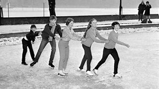 Children skating on a frozen pond