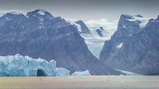View of a polar glacier and icebergs.