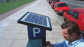 A solar panel on top of a parking ticket machine