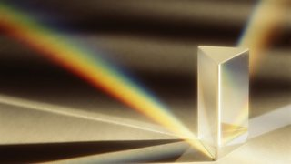 Light refracted through a prism, showing rainbow of colours