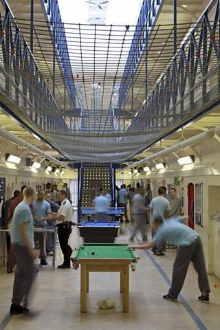 Prisoners playing pool inside a prison