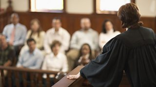 A lawyer addressing a jury in court
