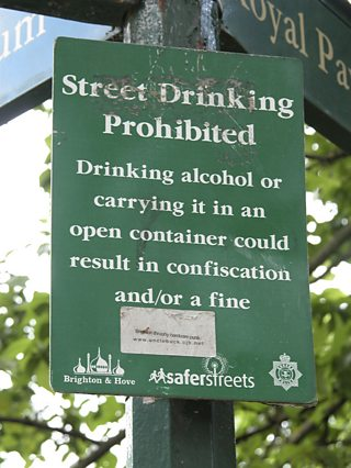 Sign prohibiting drinking in the street