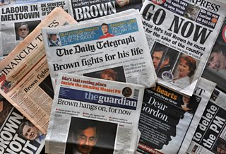 Newspapers with headlines urging Gordon Brown to quit