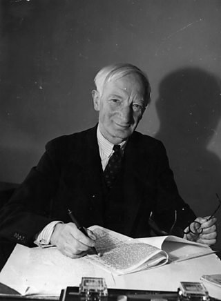 Lord Beveridge working at his desk