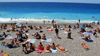 Tourists sunbathing