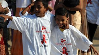 Indian schoolchildren arrive for a rally in Mumbai on World AIDS Day