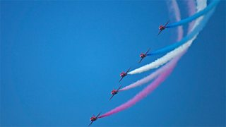 Clear blue sky with The Royal Air Force Red Arrows Aerobatic Display Team