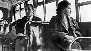 Rosa Parks seated on a bus