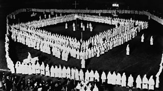 KKK members standing in a square formation at a rally in West Virginia, 1924