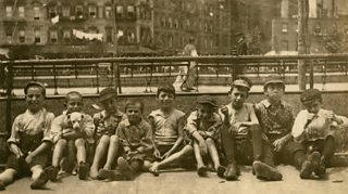 Young boys on a sidewalk of Little Italy in New York 1900