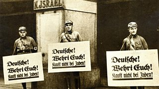 "Boycott outside Jewish store with placards saying ""Germans defend yourselves! Don't buy from Jews""."