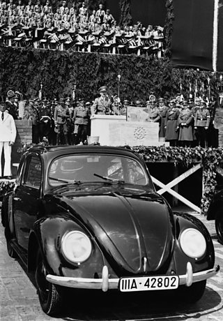 Hitler opening a Volkswagon factory with a new car in the forefront