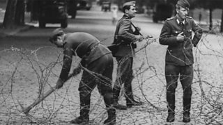 East German soldiers closing the border of East and West Berlin