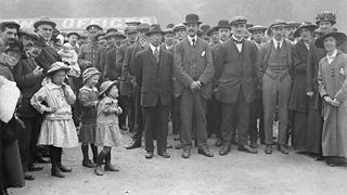 Married men conscripted in 1916 prepare to march as their families look on