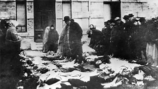 Relatives view bodies of Jewish people murdered in pogroms